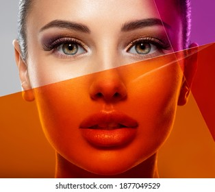 Beautiful white girl with bright eye-makeup. Beautiful fashion woman with  a colored  items.   Glamour fashion model with bright gloss make-up posing at studio. Stylish fashionable concept. Art.