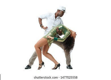 Beautiful white girl with magnificent curls and an elegant black man dancing in a pair of salsa, isolated on a white background.