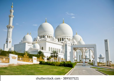 The beautiful white and gold Grand Sheikh Zayed Mosque with clear blue sky in the United Arabic Emirates