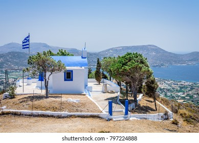 Beautiful white greek church called Agios Georgos situated on the top of a mountain near Partheni village with views to the mediterranean sea and the bay of Agia Marina, Leros, Dodecanese, Greece