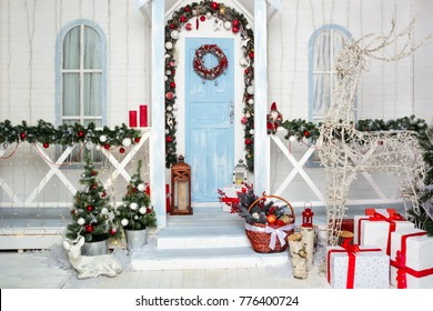 A beautiful white house decorated for Christmas. New Year. Card. Congratulation.
