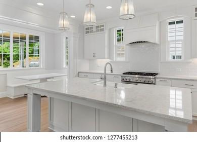 Beautiful White Kitchen in New Luxury Home with Island, Hardwood Floors