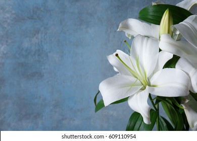 Beautiful white lilies on grunge wall background