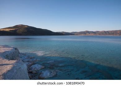 beautiful white limestone on shore of spectacular calm lake, salda golu, turkey