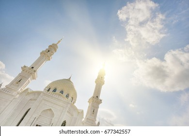 Beautiful white mosque in the sunlight