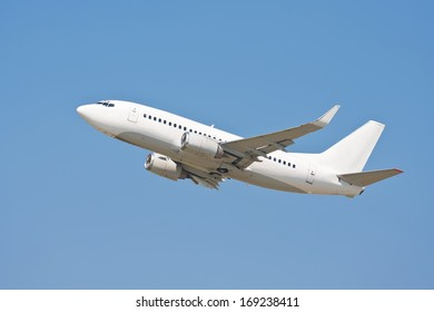 Beautiful white passenger airplane in blue sky