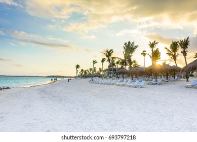 Beautiful white sand beach in Akumal, Mexico - paradise bay Beach in Quintana Roo - caribbean coast - sunset at Riviera Maya