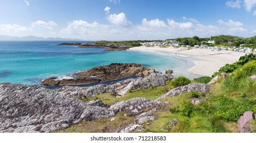 Beautiful white sand beach with camping site at Ring of Kerry, a famous coastal route in Ireland, Europe