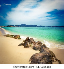 Beautiful white sand beach. Stones on a foreground. Landscape of Vietnam