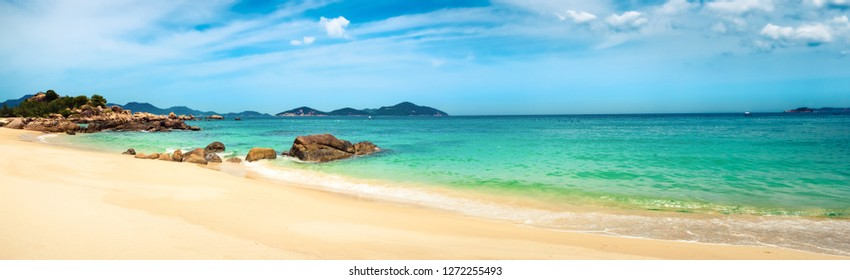 Beautiful white sand beach. Stones on a foreground. Landscape of Vietnam. Panorama