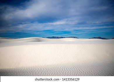 Beautiful white sand dunes and natural beach under blue skies