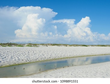 Beautiful White Sand Florida Beach and Cumulus Clouds Reflected in a Tide Pool
