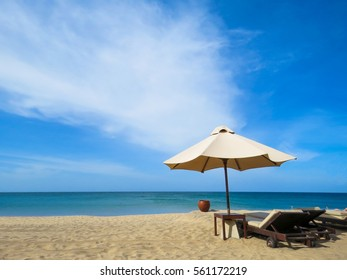 Beautiful White sand Sandy Beach with Sunbed Sun Umbrella wooden water container for washing sand off of feet