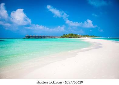 Beautiful white send beach tropical island blue lagoon. Perfect vacation relax sea view on Maldive