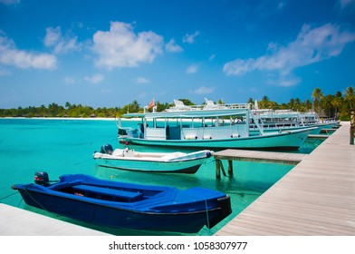 Beautiful white send beach tropical island blue lagoon with pier and boat. Perfect vacation relax sea view on Maldive