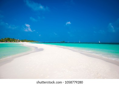 Beautiful white send beach tropical island blue lagoon with marine spit. Perfect vacation relax sea view on Maldive