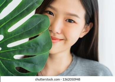 beautiful white shirt asian woman enjoy playing with green leaf vegetable vegan ides concept on white  bed holiday lifestyle