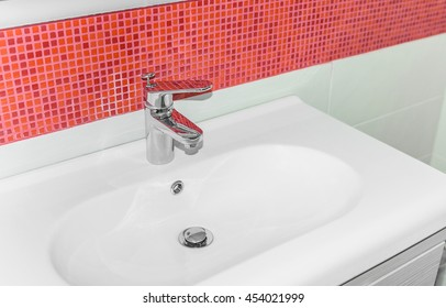 Beautiful white sink in the bathroom close up.