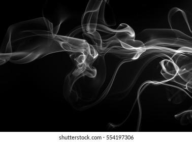 beautiful white smoke on black background darkness concept