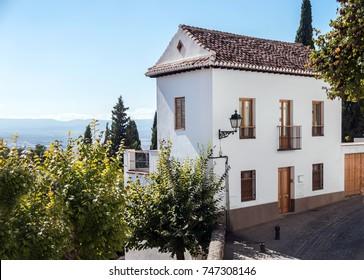 Beautiful white summer house over far landscape
