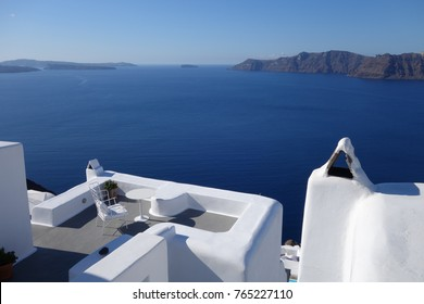Beautiful white terrace with amazing view on aegean sea