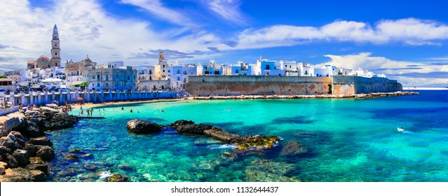 Beautiful white town Monopoli in Puglia with turquoise sea. Italy