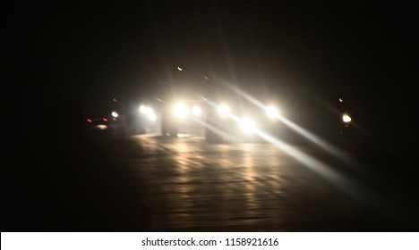 Beautiful white vehicles headlamp on the road isolated blurry photo