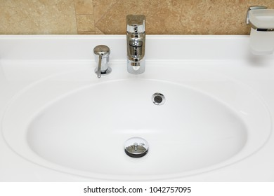 Beautiful white washbasin with built-in soap dish for liquid soap
