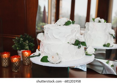 Beautiful White  Wedding Cake With Flowers and candles