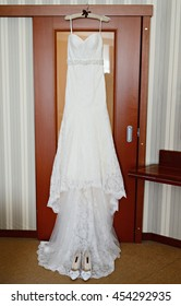 Beautiful white wedding dress for bride indoors. Beauty of bridal gown for marriage. Female lace clothes for celebration
