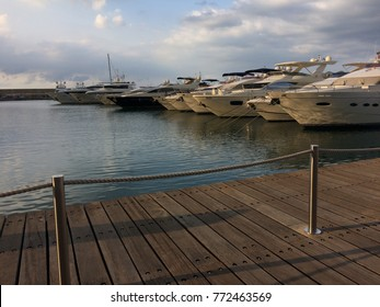 Beautiful white yachts, side by side, in a marina in Lebanon, shot from the bank.