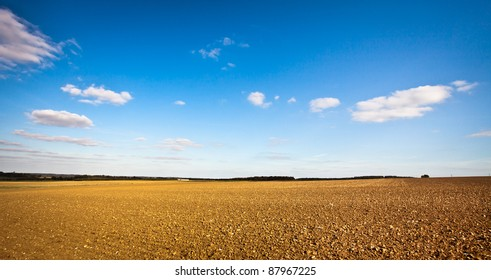 Beautiful wide angle image of a freshly tilled field in the UK on a crisp autumn day, could be used as a template with plenty of copyspace