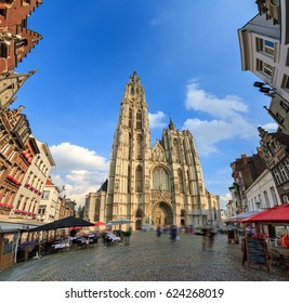 Beautiful wide angle view of the Cathedral of Our Lady (Onze-Lieve-Vrouwekathedraal) seen from the Handschoenmarkt in Antwerp, Belgium, on a summer day with a blue sky