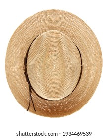 Beautiful wide-brimmed wicker hat fedora woven from straw, isolated on a white background. Top view.