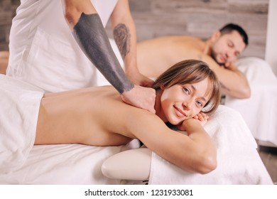 beautiful wife and her husband are in the spa salon. side view photo. close up photo