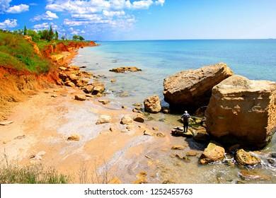 Beautiful wild beach Fontanka 2 near Odessa. Black sea Shore landscape with sandstone cliffs