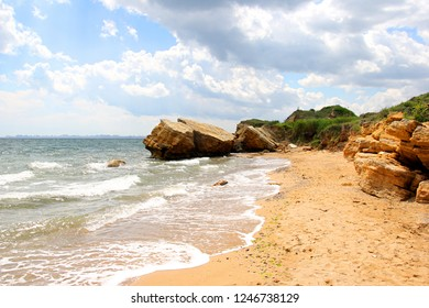 Beautiful wild Beach Fontanka  near Odessa. Yellow and red sandstone cliffs are located on the seafront. Sunny day