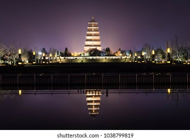 The beautiful Wild Goose Pagoda, illuminated by night and reflected on the water, Xi'An, China