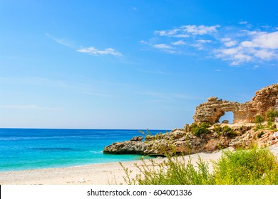 beautiful wild sandy beach with a cliff. ionian sea in Dhermi, Albania