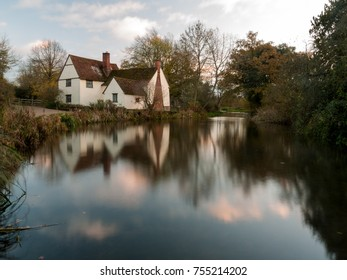 beautiful willy lotts cottage autumn long exposure blurred water constable country flatford mill; suffolk; england; uk