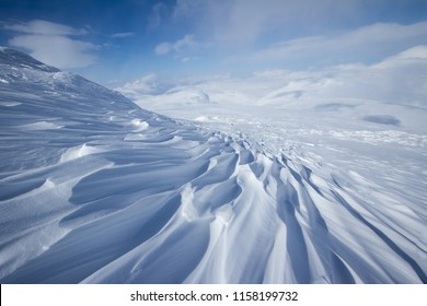 Beautiful wind textured snow in cold, windy winter mountain conditions in Swedish Lapland.
