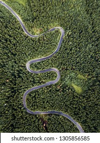 Beautiful winding,curvy road with evergreen trees,captured from above with drone at Transylvania,Romania