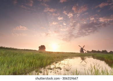 beautiful windmill at summer sunrise, Holland