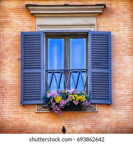 beautiful window with blue shutters and flowers in hanging flower pots, square image
