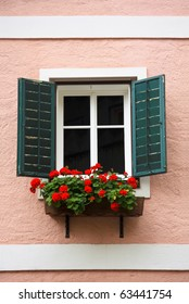 Beautiful window with flower box and shutters