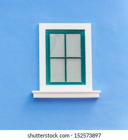 Beautiful window on color wall