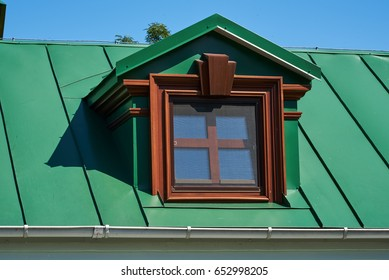 Beautiful window on the roof of the house