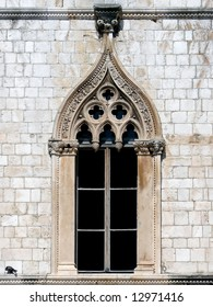 Beautiful window of Sponza Palace in Gothic-Renaissance style in Dubrovnik which is said to hold 7000 volumes and over 100.000 individual manuscripts from the Republic.
