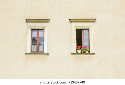 Beautiful windows on the wall of an old house.
