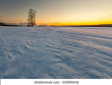 Beautiful winter after sunset landscape of fields. Long exposure of european fields in winter. Colorful landscape
